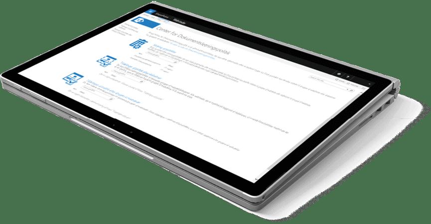 En Microsoft Surface Book 2 der ligger og viser SharePoint på skærmen
