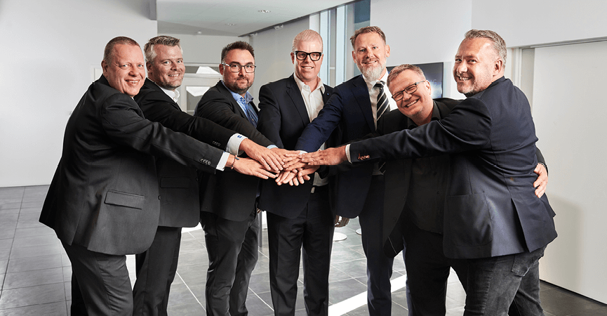 Fra venstre er Michael Kjærgaard Jensen, Martin Lund Hansen, Morten Gad, Nicolai Voll, CEO Nis Bank Lorenzen, Thomas Belsø og Jacques D. Møller. Alle Partnerer hos JDM